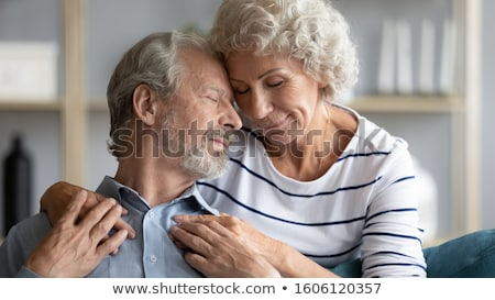 Stock photo: husband and wife in a moment of tenderness