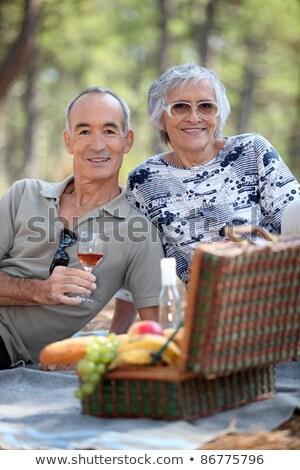 casal · de · idosos · alimentação · potável · piquenique · verão · fruto - foto stock © photography33