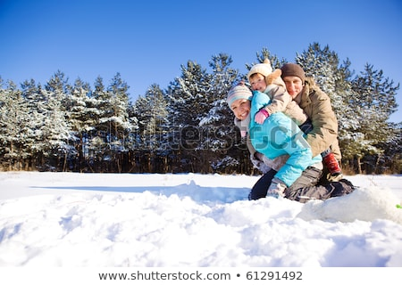 Little girl playing in the snow with her parents Stock photo © photography33