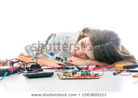 Female laborer exhausted sleeping in a hand Stock photo © photography33