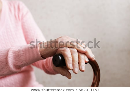 hands of an old woman with a cane stock photo © courtyardpix