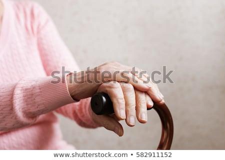 Mains vieille femme canne vieux paysan femme Photo stock © courtyardpix