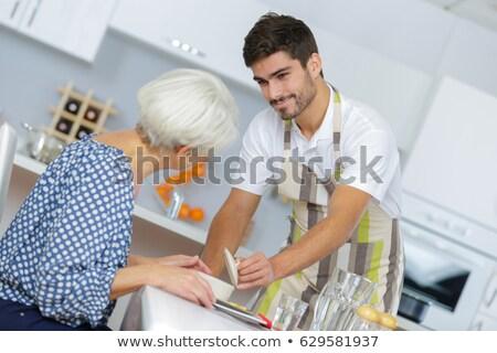 człowiek · pomoc · młody · chłopak · kuchnia · laptop · uśmiechnięty - zdjęcia stock © photography33