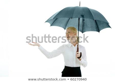 pretty business woman holding opened umbrella stock photo © photosebia