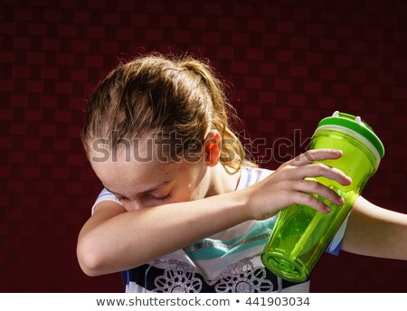 Woman trying to cool off after a workout Stock photo © photography33
