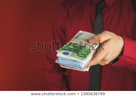 handsome businessman holding a bundle of money stock photo © wavebreak_media