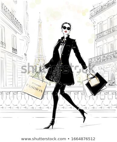 Mooie jonge brunette zwarte jas leggings Stockfoto © acidgrey