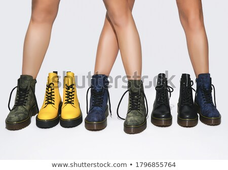 beautiful legs with a young woman in leather boots isolated stock photo © acidgrey