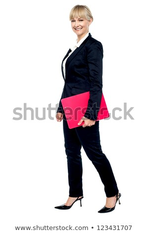 Energetic employee walking with her clipboard Stock photo © stockyimages