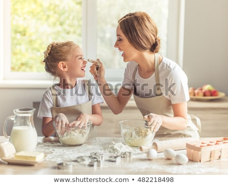 Laughing woman baking cookies with her daughter in kitchen stock photo © wavebreak_media