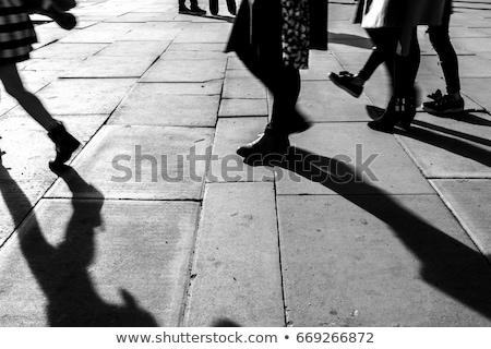 Emberek sétál utca hosszú árnyékok tömeg Stock fotó © meinzahn