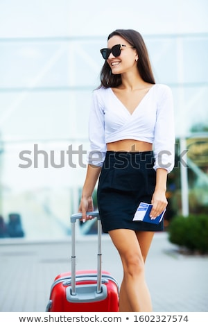 Closeup portrait of young positive woman holding passport and th Stock photo © HASLOO