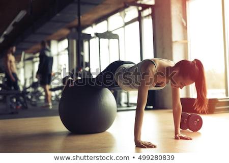 Fitnessz nő egyensúlyozó labda portré vonzó térdel nő Stock fotó © williv
