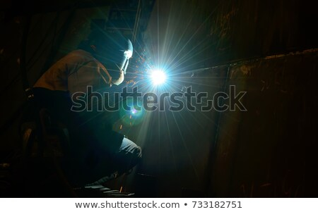 worker grinding metal inside of shipyard stock photo © mady70