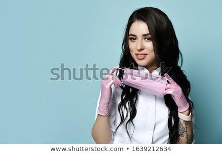улыбаясь элегантный женщину врач Постоянный ног Сток-фото © fantasticrabbit