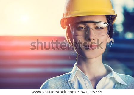 attractive woman on construction site stock photo © aikon