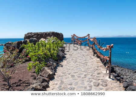 scenic view to the promenade of playa blanca lanzarote from sea stock photo © meinzahn