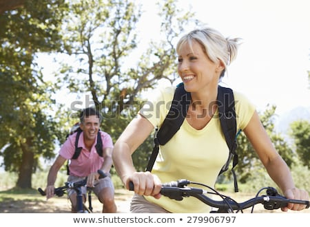 mature woman on cycle ride in countryside stock photo © monkey_business