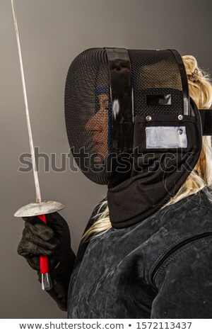 Stock photo: Female fencer practicing her fencing technique