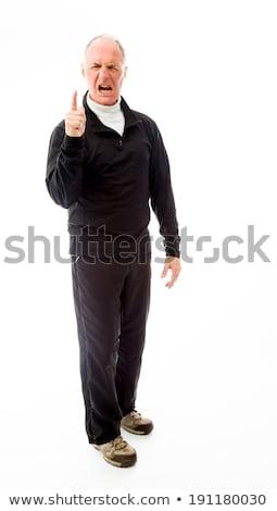 upset senior man scolding somebody stock photo © bmonteny