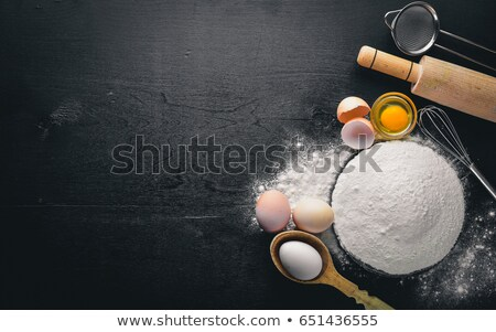 vintage wooden spoon and egg  Stock photo © RedDaxLuma