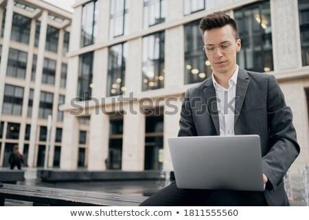 hombre · de · negocios · plata · portátil · aislado · blanco - foto stock © raphotos