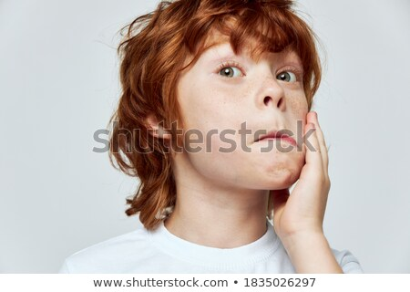 Redhair teenager closes his face Stock photo © deandrobot