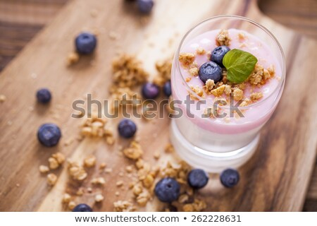 delicious dessert flakes flooded in two flavors yogurt with blu stock photo © brunoweltmann