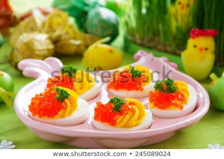 Apetitoso huevo relleno rojo caviar peces Foto stock © g215