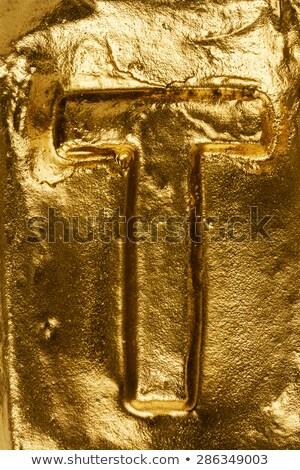 Hecho a mano cerámica letra t pintado oro aislado Foto stock © Taigi