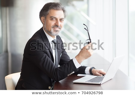 Happy male executive posing Stock photo © stockyimages