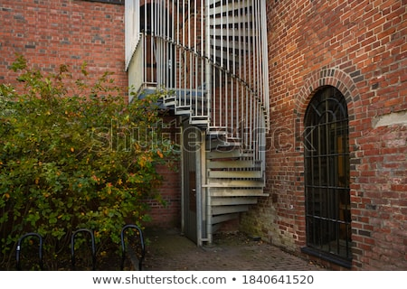 spiral staircase metal brick architecture historic building inte stock photo © cboswell