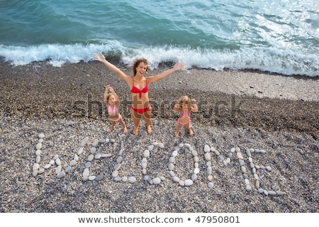 Inscription from stones WELCOME at stony coast Stock photo © Paha_L