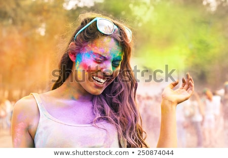 Happy young woman on holi color festival Stock photo © dashapetrenko