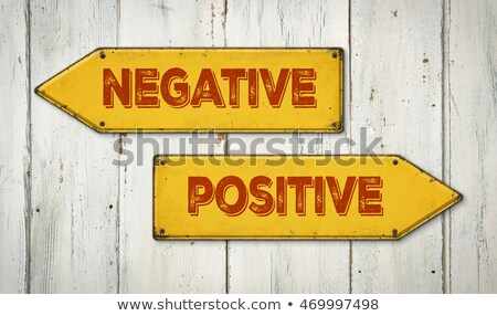 Direction signs on a wooden wall - Negative or Positive Stock photo © Zerbor