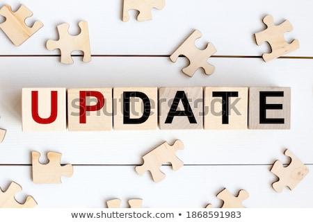 Rompecabezas palabra actualizar piezas del rompecabezas construcción tecnología Foto stock © fuzzbones0
