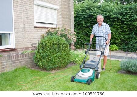 idős · férfi · gyep · kert · mosoly · fű - stock fotó © lightpoet