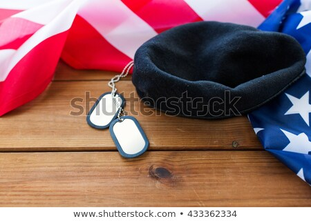 close up of american flag, hat and military badge Stock photo © dolgachov