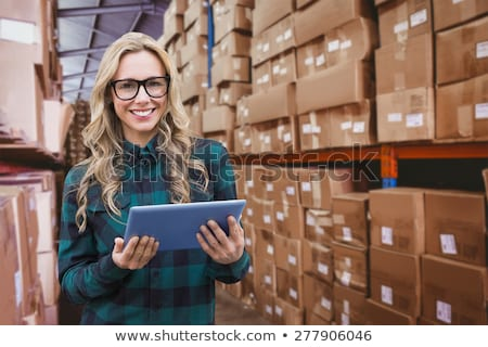 Composite image of pretty blonde with tablet Stock photo © wavebreak_media