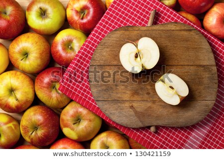 red apples and towel on the old boards stock photo © karpenkovdenis