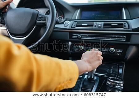 Female driver shifting gear manually Stock photo © stevanovicigor