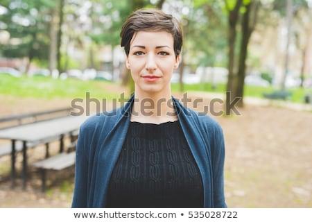 Portré fiatal töprengő nő néz kamera Stock fotó © deandrobot
