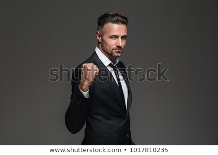 человека костюм кулаком синий глядя Сток-фото © deandrobot