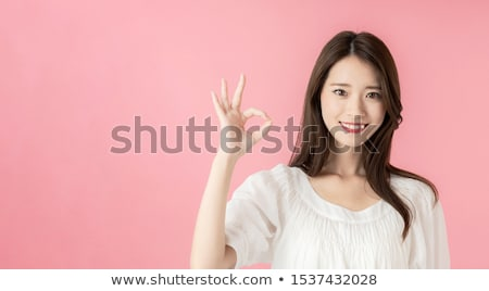 happy asian young woman showing ok hand sign Stock photo © dolgachov