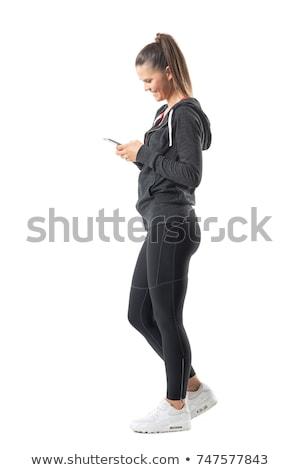 Teljes alakos portré csinos mosolygó nő sportruha nyújtás Stock fotó © deandrobot