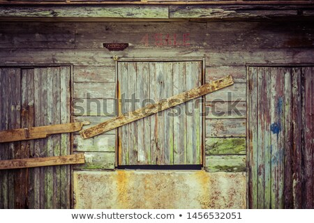 old wodden window shutter of traditional house in the village chamaitoulo crete greece stock photo © ankarb