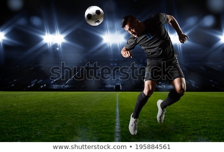 Large footballer heading ball Stock photo © IS2