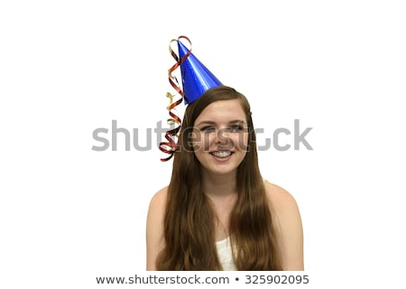 young woman wearing party hat with party streamer stock photo © is2