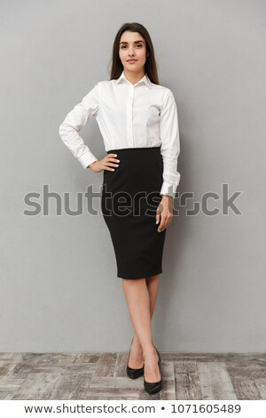 Portrait of intelligent office woman with long brown hair in whi Stock photo © deandrobot
