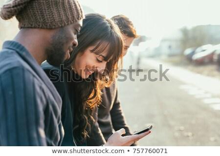 счастливым группа друзей телефонов фото Сток-фото © deandrobot
